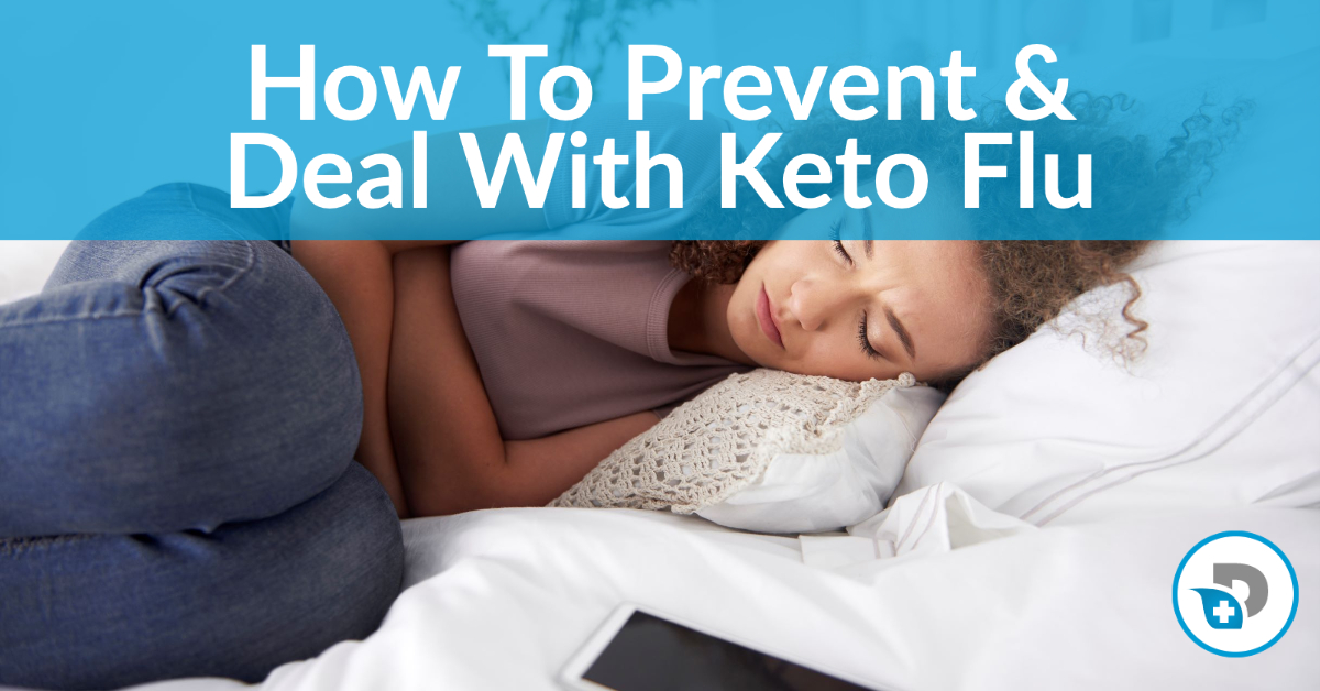 A woman lays in bed suffering from keto flu